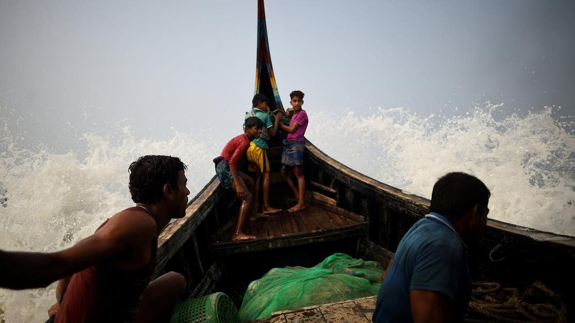 Waves hit a fishing boat crewed by Rohingya refugees in the Bay of Bengal near Cox's Bazaar, Bangladesh. (Reuters)