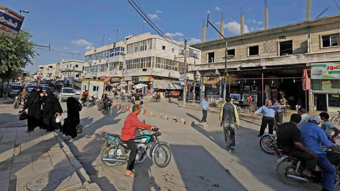 A picture taken on June 6, 2018, shows people walking in a street in the northern Syrian town of Manbij. (AFP)