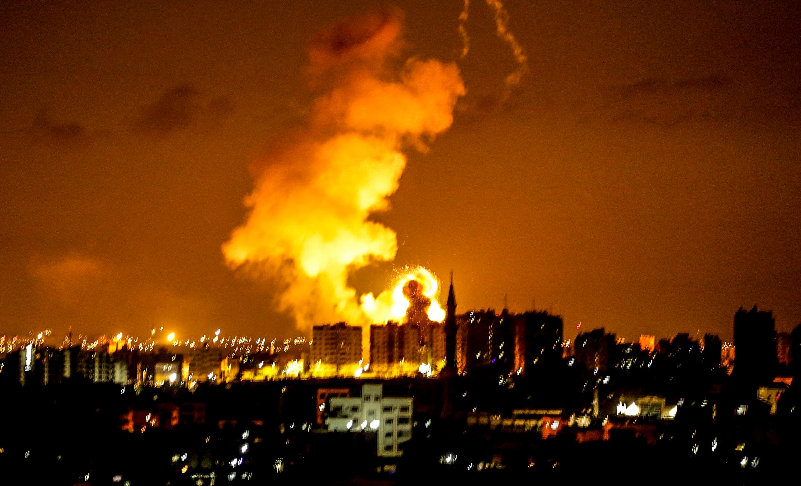 An explosion is seen in Gaza City after an airstrike by Israeli forces on June 18, 2018.  (AFP)