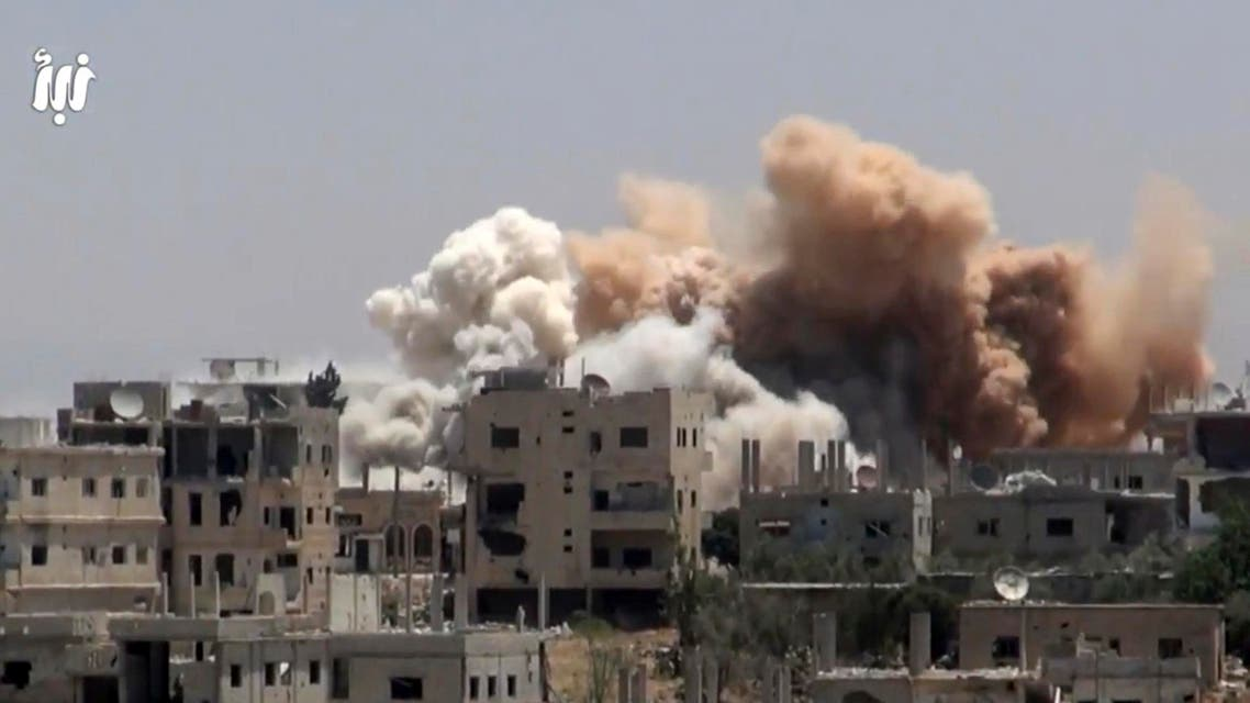 This frame grab from video provided on Monday, June 12, 2017, by Nabaa Media, a Syrian opposition media outlet that is consistent with independent AP reporting, shows smoke rising over buildings that were hit by Syrian government forces bombardment, in Daraa city, southern Syria. (AP)