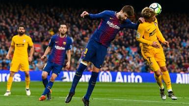 """برشلونة يوبخ بيكيه بعد """"قرار"""" غريزمان"""