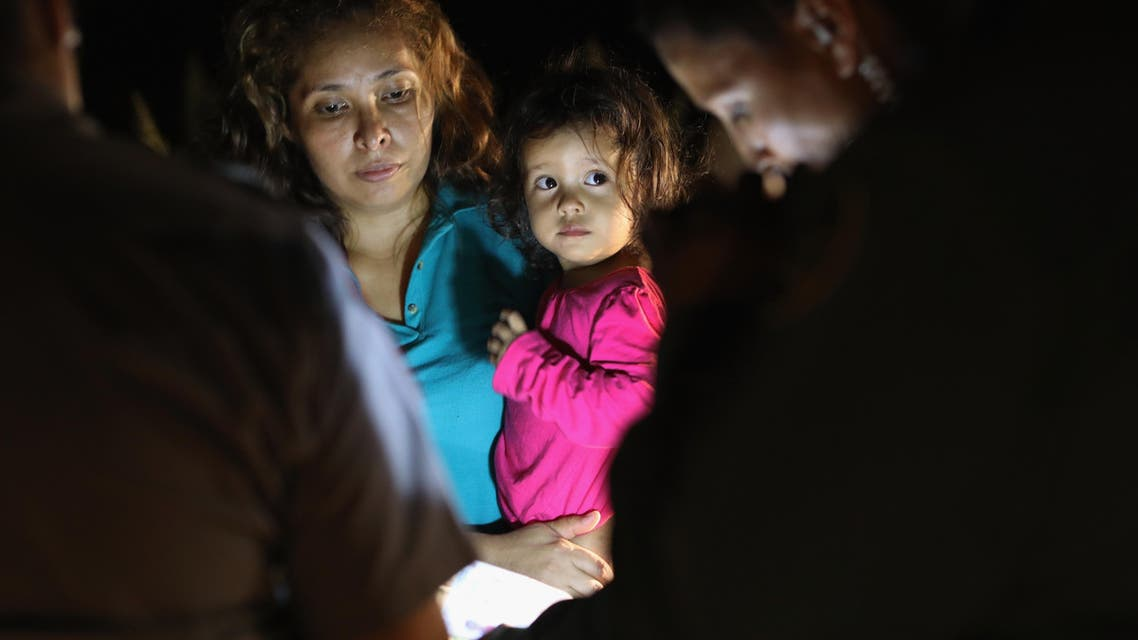 Central American asylum seekers, including a Honduran girl, 2, and her mother, are taken into custody near the U.S.-Mexico border on June 12, 2018 in McAllen, Texas. (AFP)