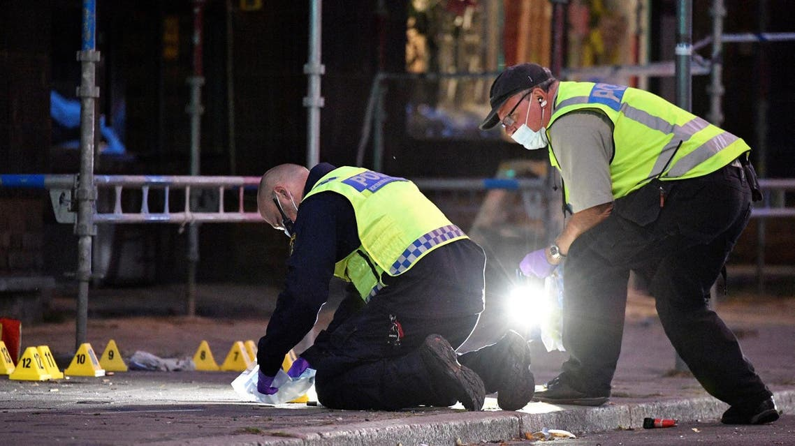 Police forensics search area after the shooting on a street in central Malmo on June 18, 2018. (Reuters)