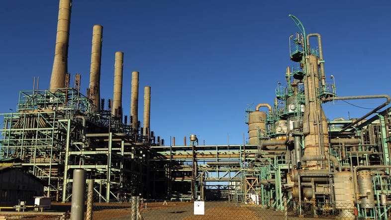 Clashes at Libya oil ports cut output by nearly half - Al