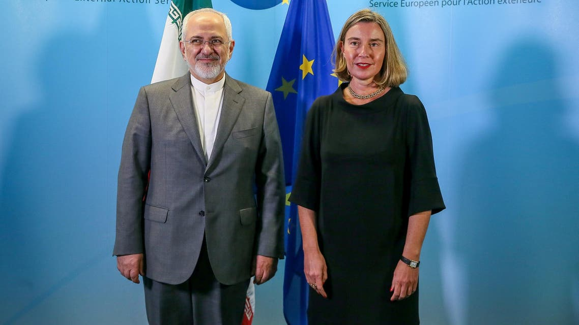 Iran's Foreign Minister Mohammad Javad Zarif (L) with European Union Foreign Policy Chief Federica Mogherini in Brussels on April 25, 2018. (AFP)