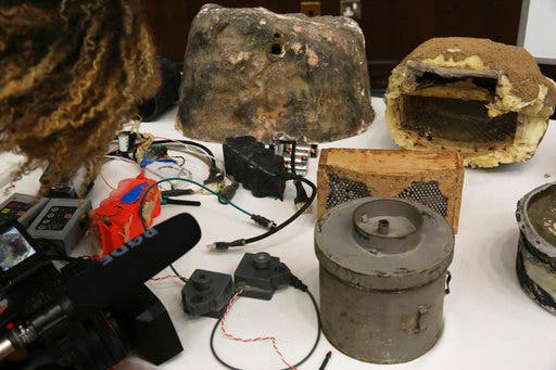 Improvised explosives disguised as rocks, that officials said came from the battlefield in Yemen, during a news conference in Abu Dhabi, United Arab Emirates, Tuesday, June 19, 2018. (AP)