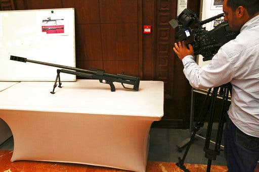 A videographer films a sniper rifle that officials described an Iranian-made rifle captured on the battlefield in Yemen, during a news conference in Abu Dhabi, United Arab Emirates, Tuesday, June 19, 2018. (AP)
