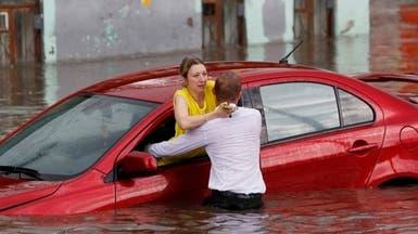 """بالصور.. بطل """"غير كروي"""" بكأس العالم أنقذ نساء من الغرق"""