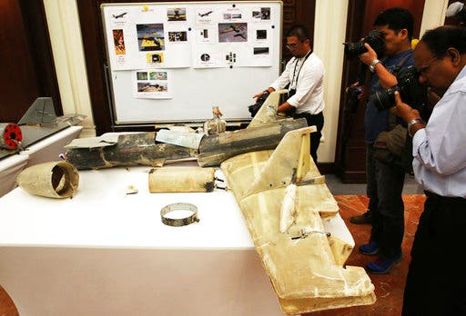 Photographers take pictures of what officials described as an Iranian Qasef drone captured on the battlefield in Yemen during a news conference in Abu Dhabi, United Arab Emirates, Tuesday, June 19, 2018. (AP)