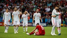 Spain survive 'heart attack' game against feisty Iran