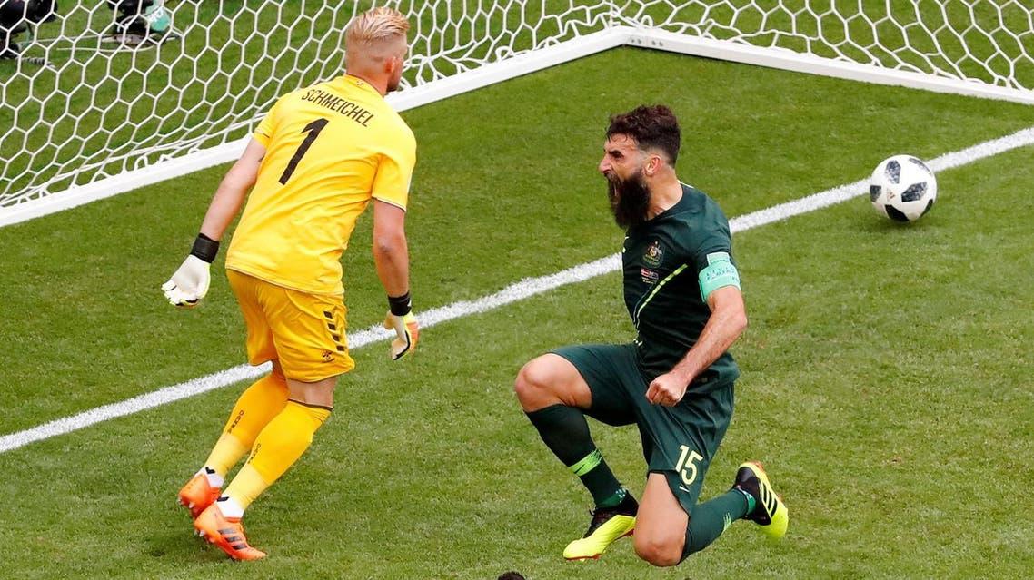 Australia's Mile Jedinak celebrates scoring their first goal (Reuters)