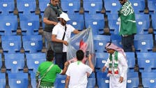 Saudi World Cup fans in Russia clean their stadium stands following match
