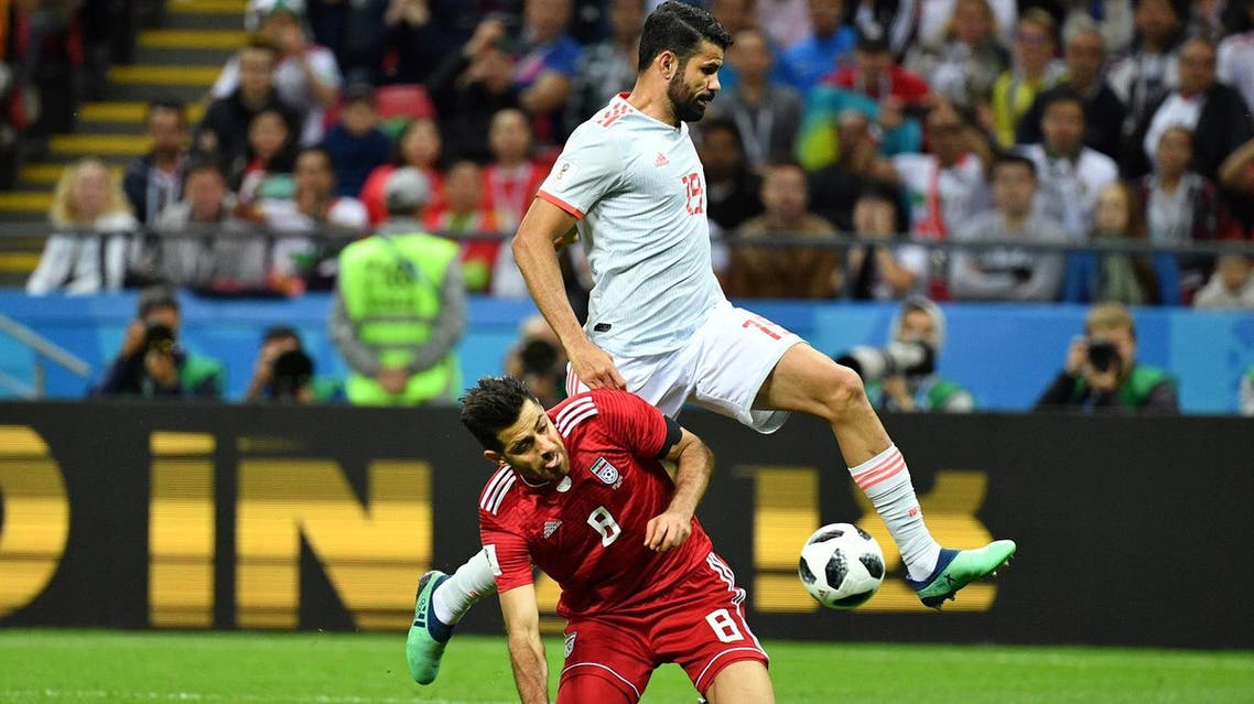 Iran's defender Morteza Pouraliganji (L) vies for the ball with Spain's forward Diego Costa during the Russia 2018 World Cup Group B football match on June 20, 2018. (AFP)