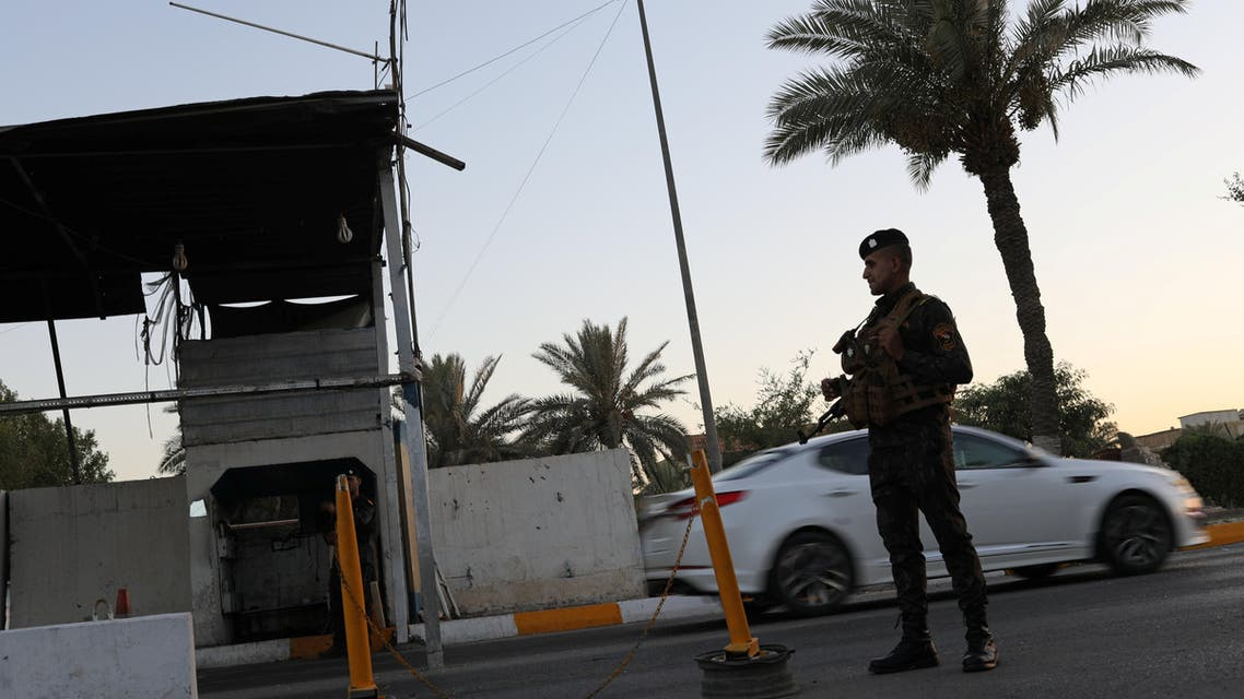 An Iraqi policeman stands guard at a check point in Baghdad, Iraq June 20, 2018. REUTERS