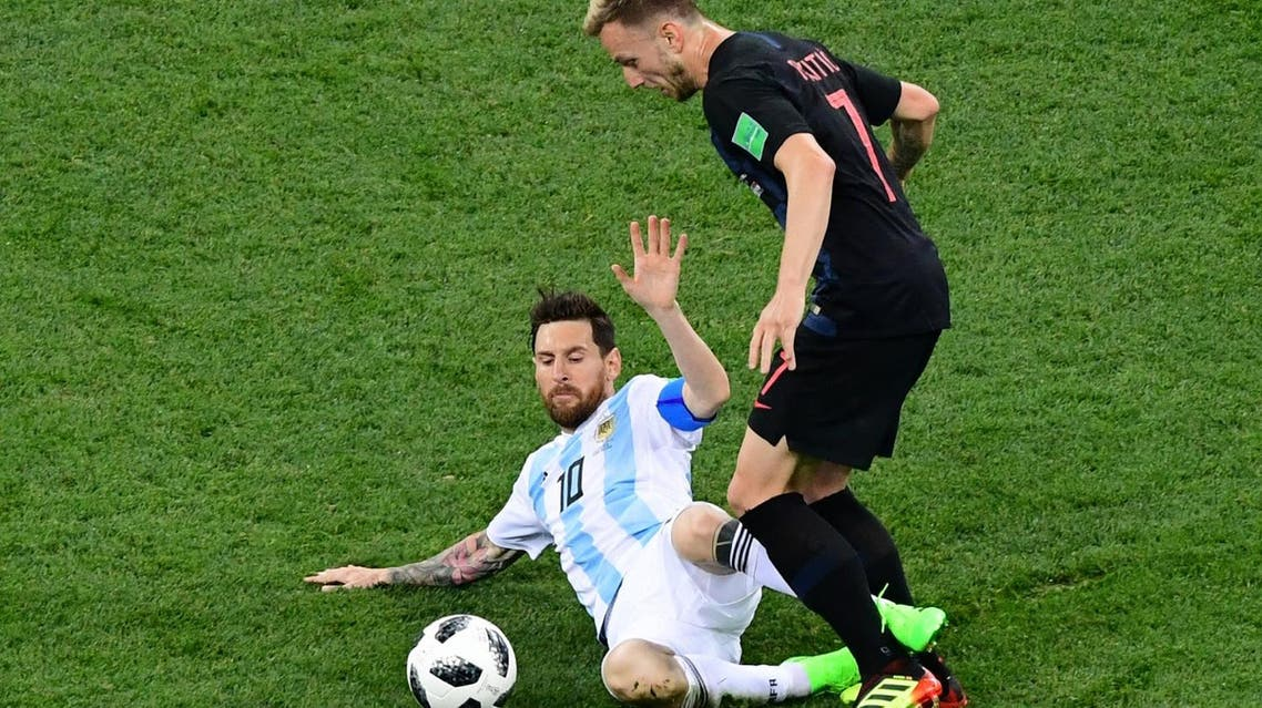 Argentina's forward Lionel Messi (L) vies with Croatia's midfielder Ivan Rakitic during the Russia 2018 World Cup Group D football match between Argentina and Croatia at the Nizhny Novgorod Stadium in Nizhny Novgorod on June 21, 2018. (AFP)