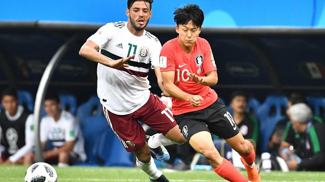 Mexico's forward Carlos Vela (L) vies with South Korea's midfielder Lee Seung-woo during the Russia 2018 World Cup Group F football match on June 23, 2018. (AFP)
