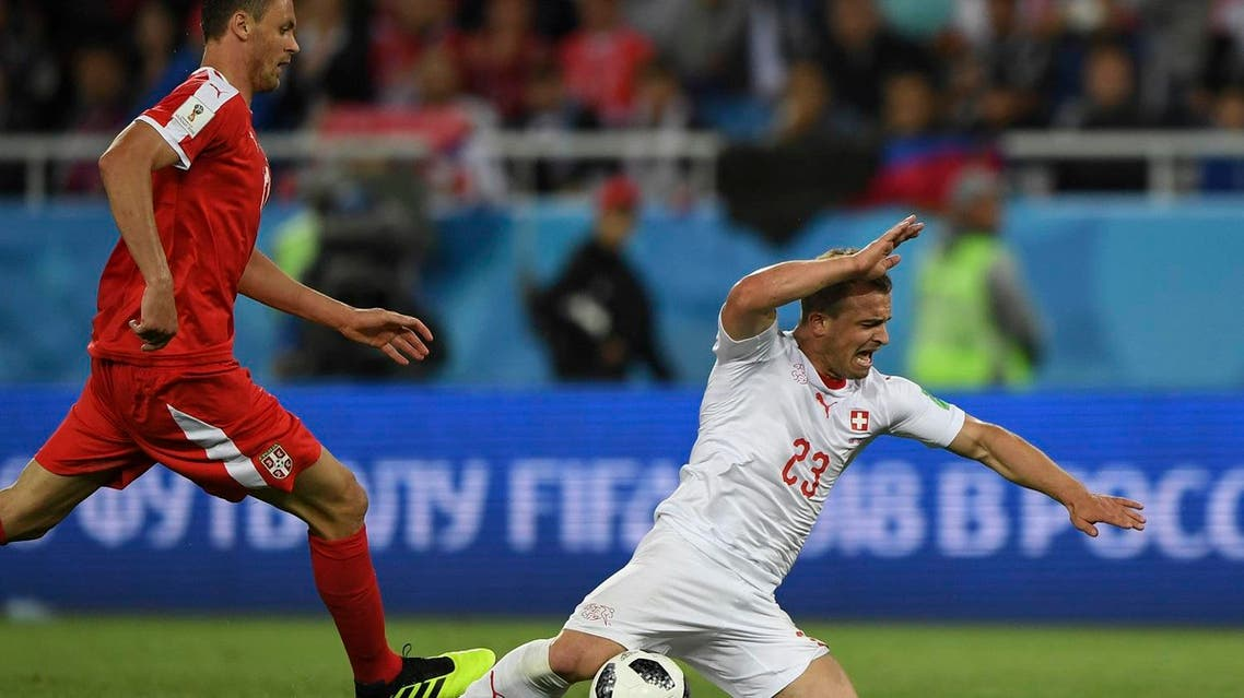 Switzerland's forward Xherdan Shaqiri (R) falls next to Serbia's midfielder Nemanja Matic during their Russia 2018 World Cup Group E football match. (AFP)