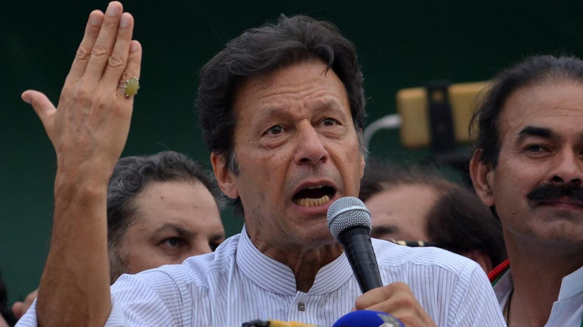 Imran Khan (C), opposition leader and head of the Pakistan Tehreek-i-Insaf (PTI) delivers a speech during an election campaign on June 24, 2018. (AFP)
