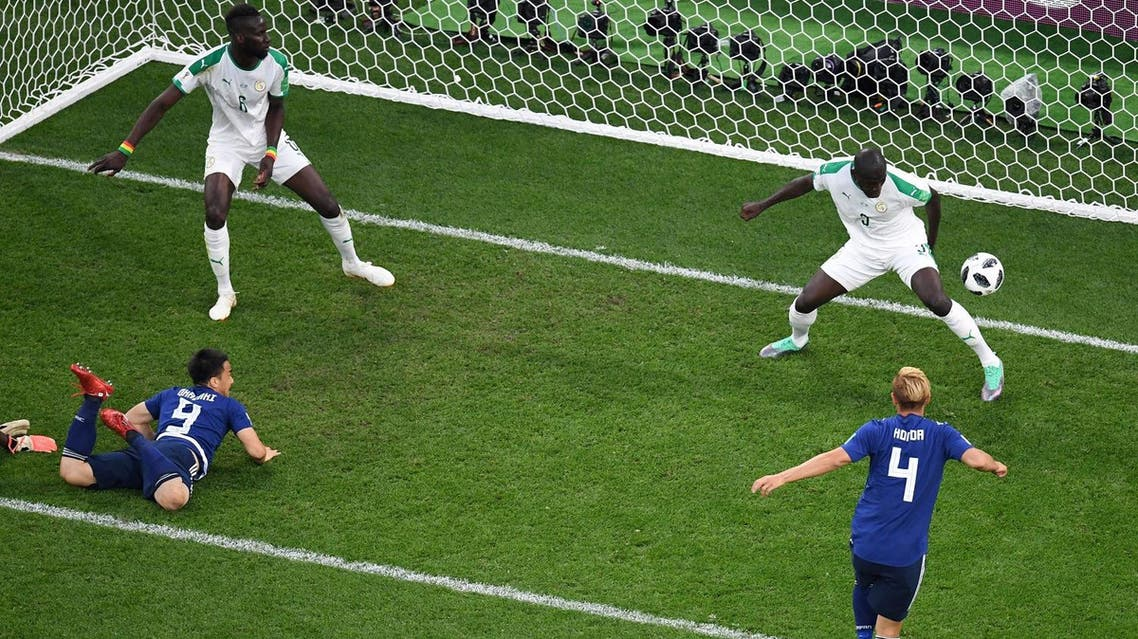 Japan's midfielder Keisuke Honda (4) scores his team's second goal against Senegal during the Russia 2018 World Cup Group H football match. (AFP)