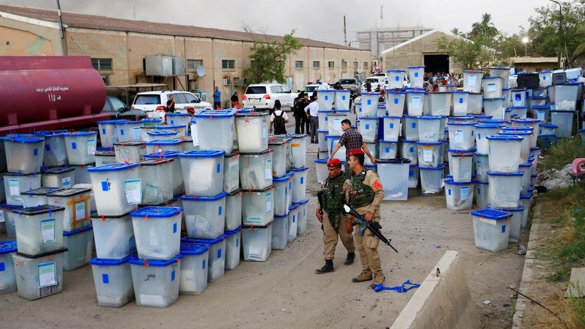 Ballot boxes are seen after a fire at a storage site in Baghdad, housing the boxes from Iraq's May parliamentary election. (Reuters)