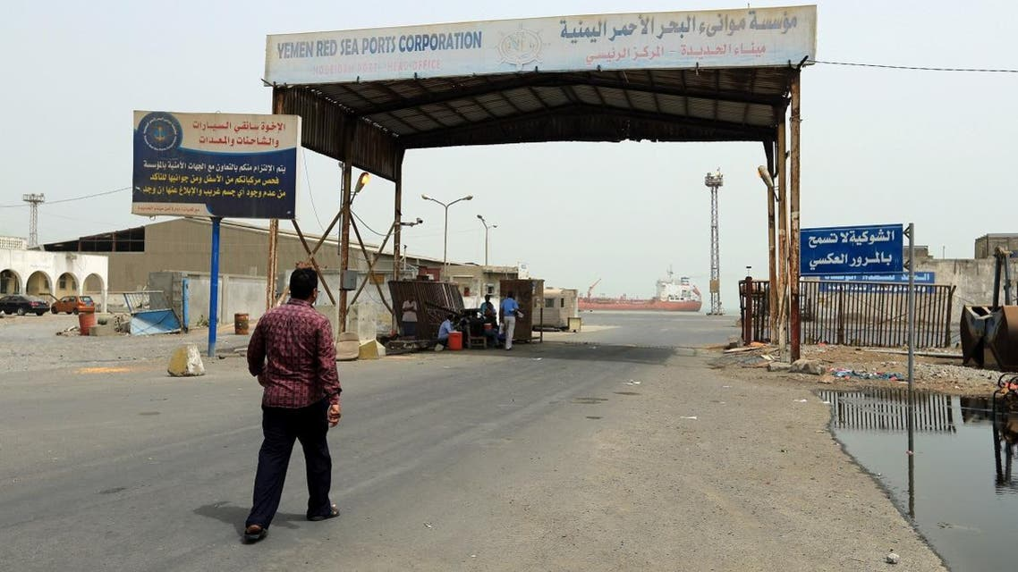 A man walks towards the gate of the Red Sea port of Hodeidah. (Reuters)