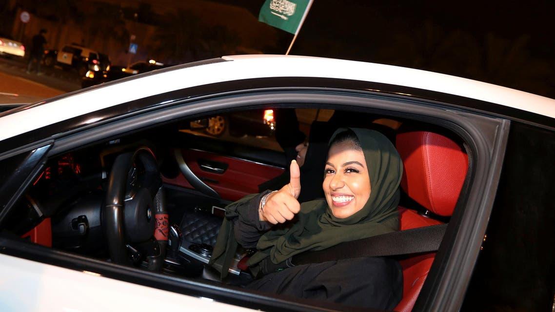 A Saudi woman celebrates as she drives her car in her neighborhood, in Al Khobar, Saudi Arabia. (Reuters)