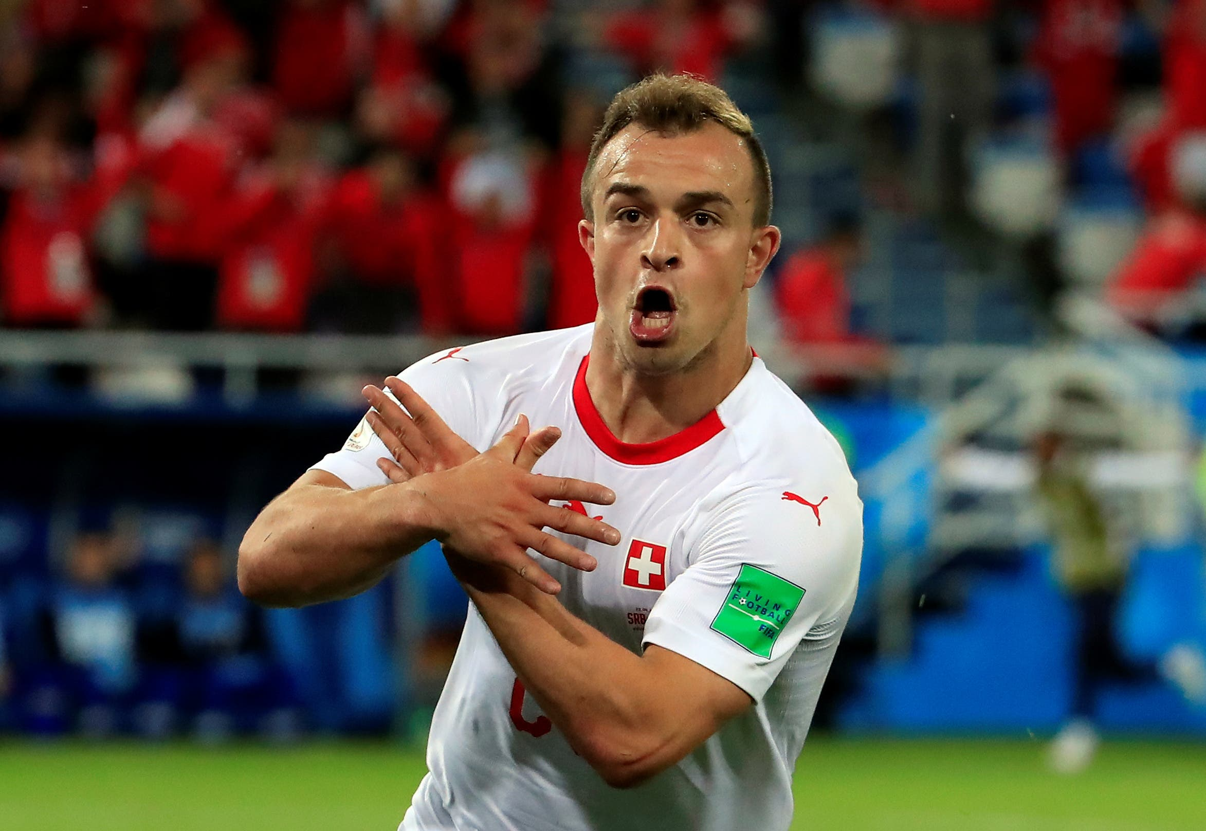 Xherdan Shaqiri celebrates his goal agaisnt South Korea which gave Switzerland the lead. (Reuters)