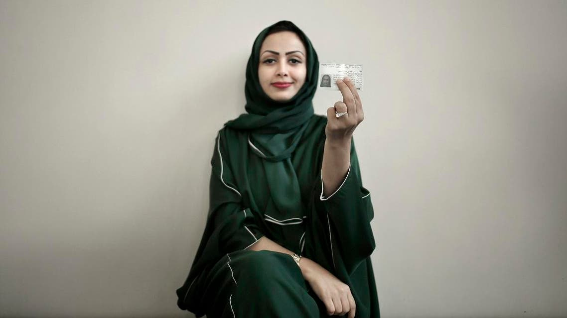 In this June 23, 2018 photo, 34-year old Asmaa al-Assdmi poses for a photograph holding her new car license at the Saudi Driving School inside Princess Nora University in Saudi Arabia. (AP)