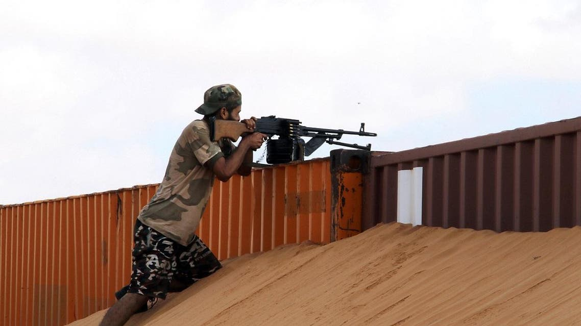 A member of the Libyan National Army carries his weapon during clashes to recover oil ports in Ras Lanuf. (Reuters)