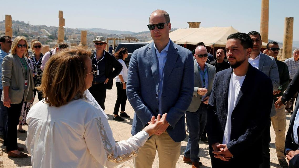 Britain's Prince William stands with Jordan's Crown Prince Hussein during his visit to the ancient city of Jerash. (Reuters)