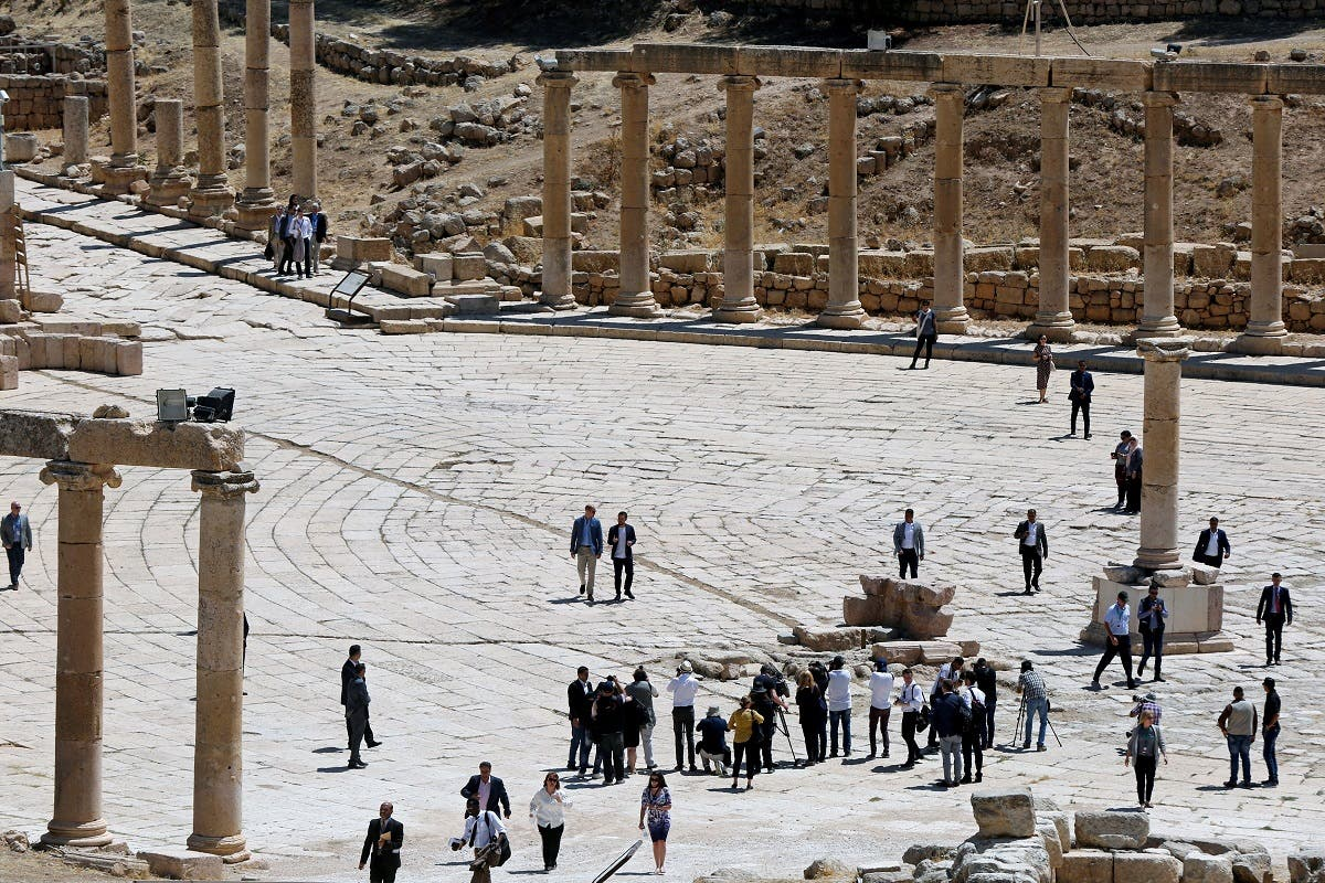 Britain's Prince William and Jordan's Crown Prince Hussein walk at the ancient city of Jerash. (Reuters)
