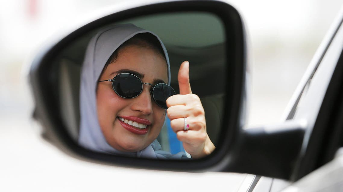 Zuhoor Assiri gestures as she drives her car in Dhahran. (Reuters)