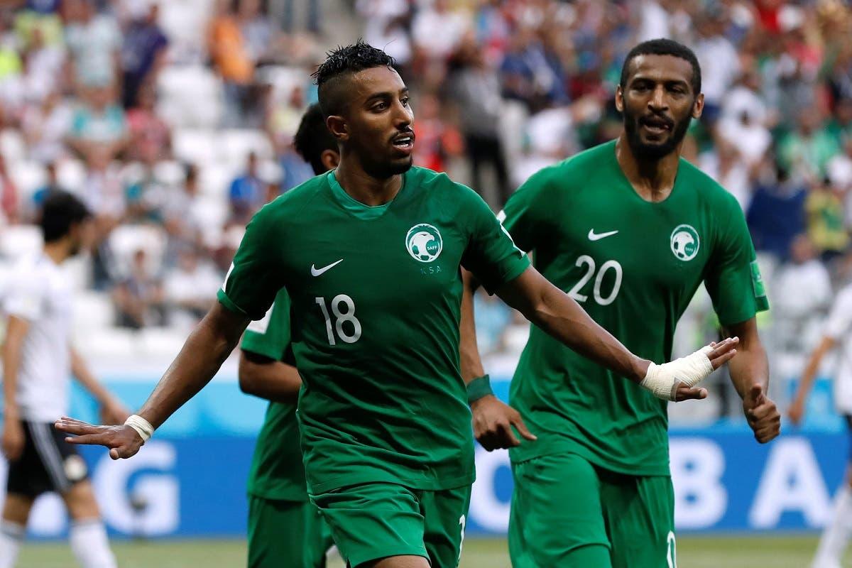 Saudi Arabia's Salem Al-Dawsari celebrates with Muhannad Assiri after scoring their second goal. (Reuters)