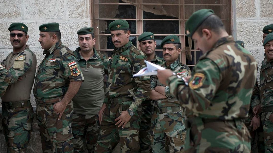 Soldiers wait to cast their ballots in early voting for Iraq's security forces. (AP)