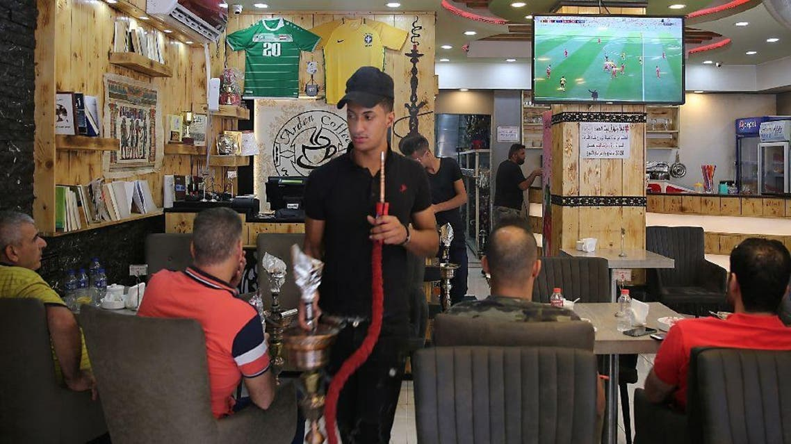 Mirroring the capital, people have crammed into cafes to watch games, happy at last to imbibe images the jihadists deemed corrupting. (AFP)
