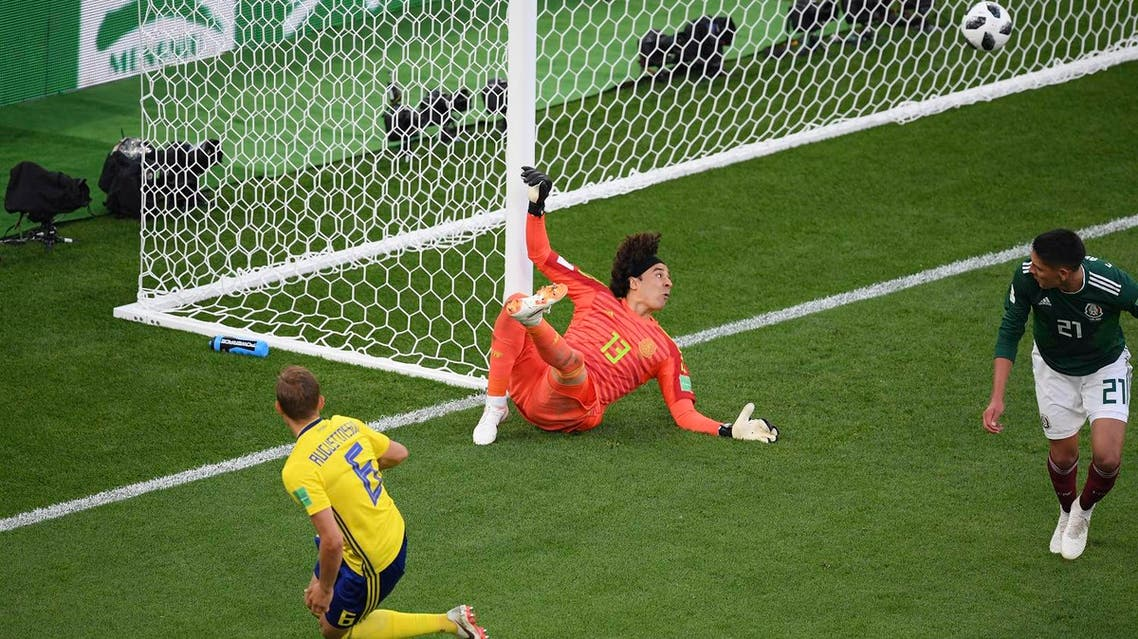 Sweden's defender Ludwig Augustinsson (L) scores the opening goal past Mexico's goalkeeper Guillermo Ochoa in the 2018 World Cup Group F football match on June 27, 2018. (AFP)