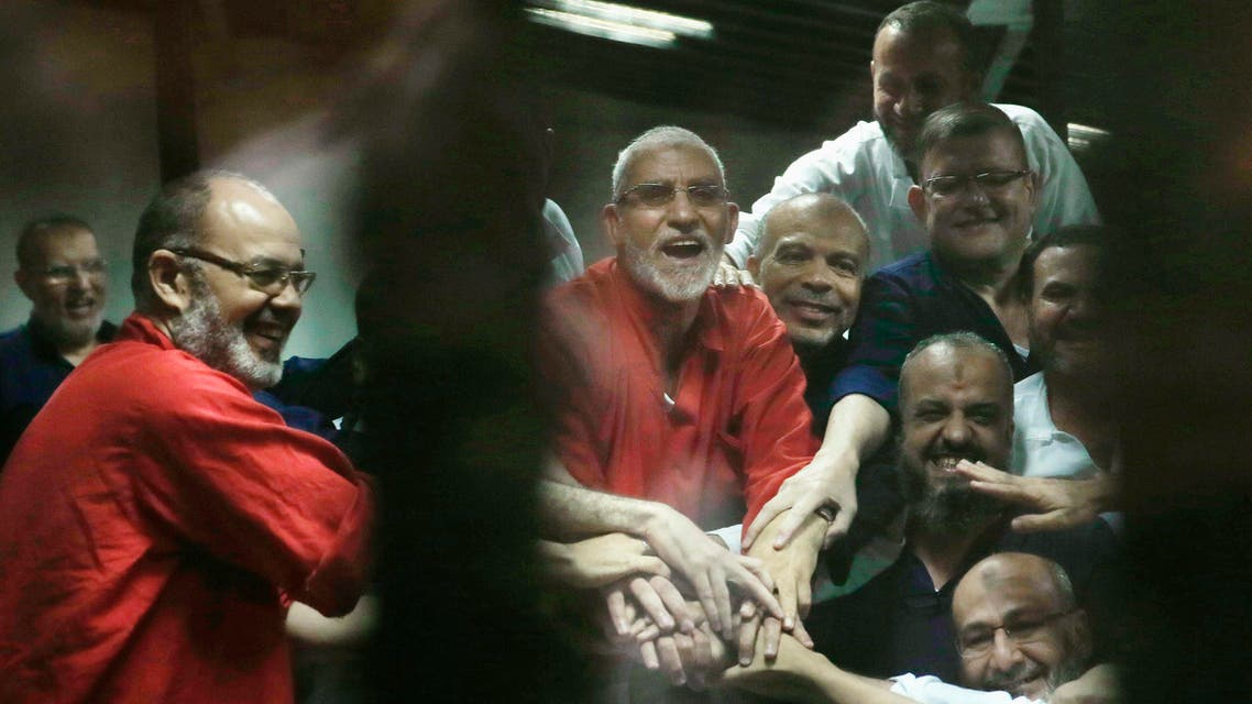 Egyptian defendants including Muslim Brotherhood spiritual leader, Mohammed Badie, center in orange, react to a court ruling in Cairo on June 16, 2015. (AP)