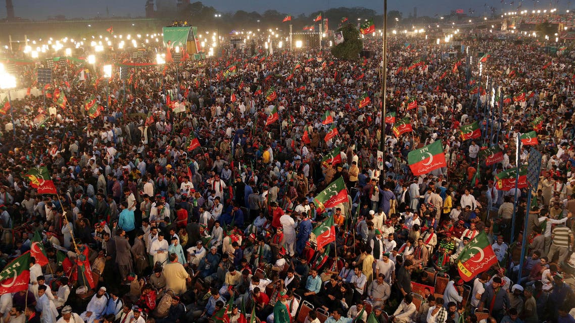 Supporters of opposition leader Imran Khan's party Tehreek-e-Insaf attend a rally in Lahore, Pakistan. (AP)