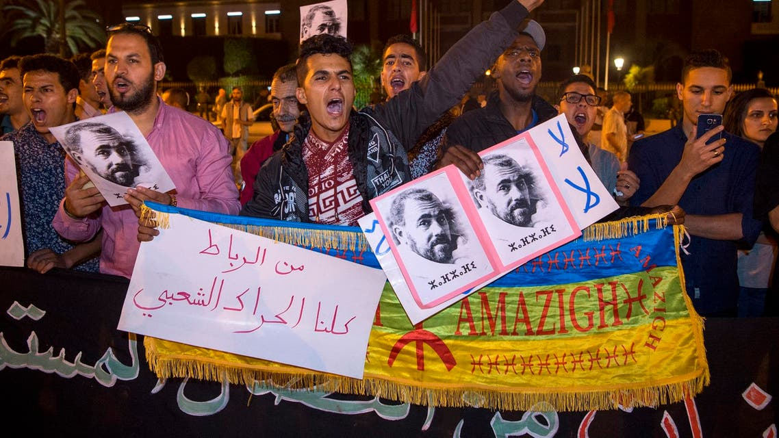 Protesters hold portraits of grassroots leader Nasser Zefzafi during a demonstration June 4, 2017 in Rabat in solidarity with Morocco's neglected Rif region. (AFP)