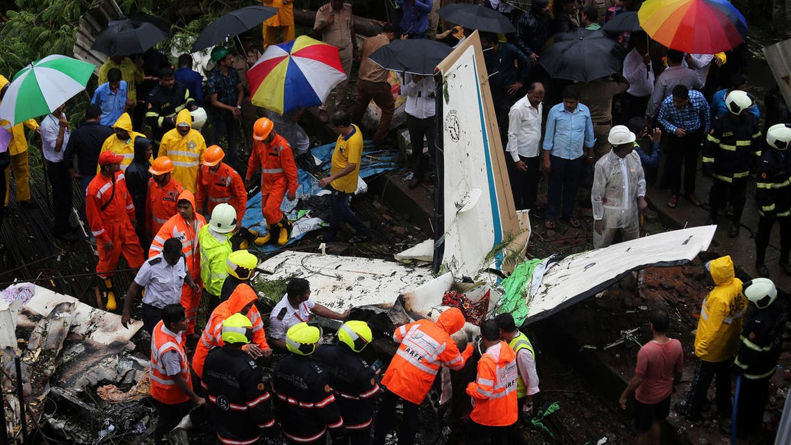 Firefighters and aircraft rescue workers inspect the site of a plane crash in Mumbai on June 28, 2018. (Reuters)
