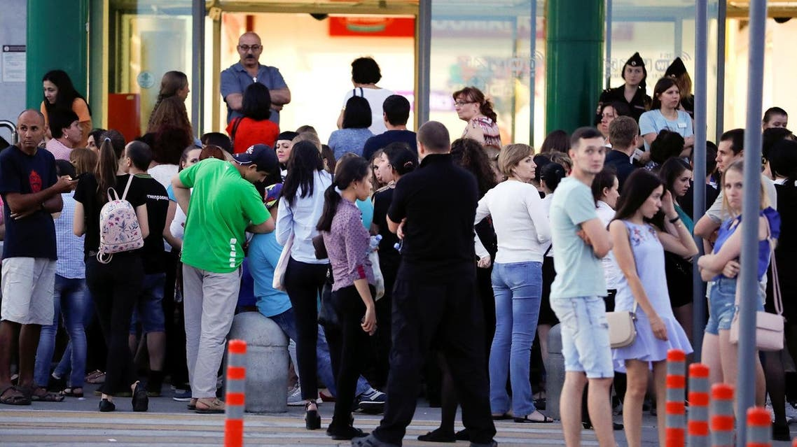 People stand outside a mall that was evacuated in the World Cup city of Samara, Russia, on June 28, 2018. (Reuters)