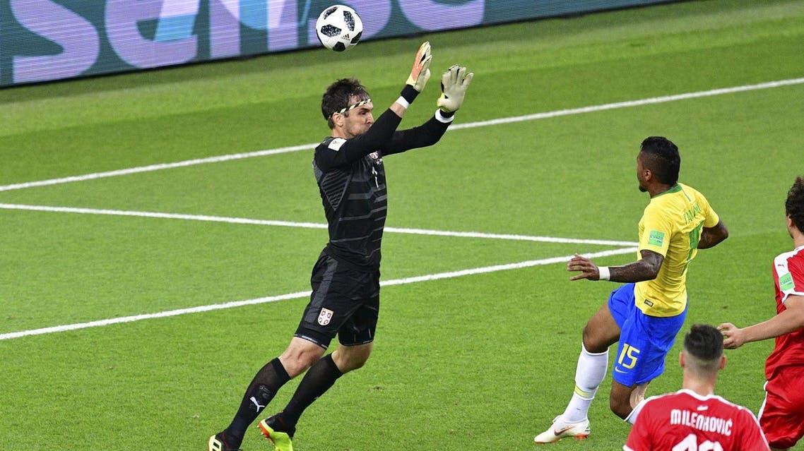 Brazil's midfielder Paulinho (R) scores a goal past Serbia's goalkeeper Vladimir Stojkovic (L) during the Russia 2018 World Cup Group E football on June 27, 2018. (AFP)