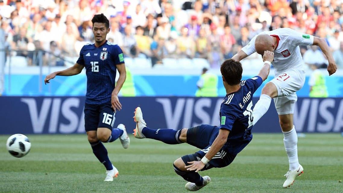Poland's midfielder Rafal Kurzawa (R) kicks the ball past Japan's Hiroki Sakai (C) and Hotaru Yamaguchi during the Russia 2018 World Cup Group H football match on June 28, 2018. (AFP)