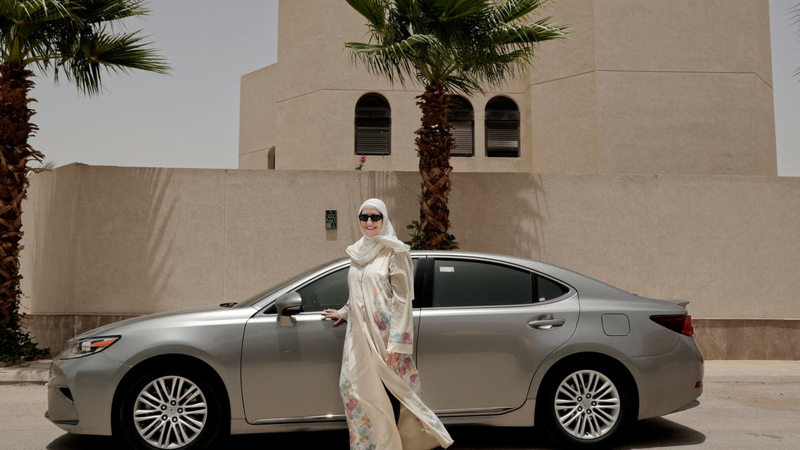 Ammal Farahat, who has signed up to be a driver for Careem, a regional ride-hailing service that is a competitor to Uber, poses for a photograph next to her car on a street in Riyadh, Saudi Arabia. (AP)