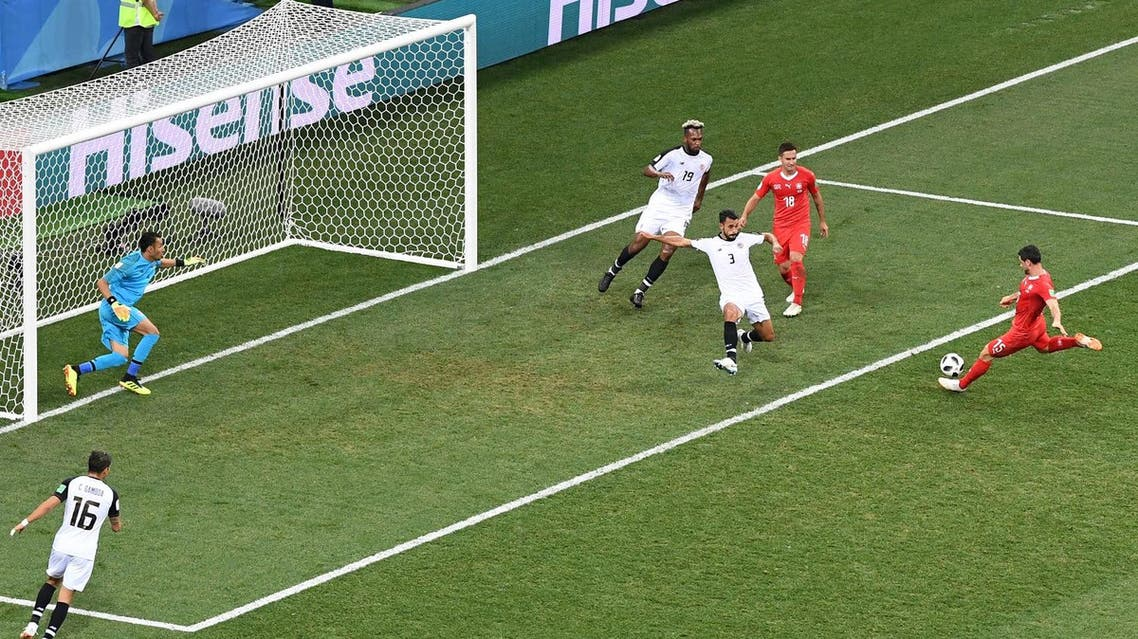 Switzerland's midfielder Blerim Dzemaili (R) scores the opening goal during the 2018 World Cup Group E football match against Costa Rica on June 27, 2018. (AFP)