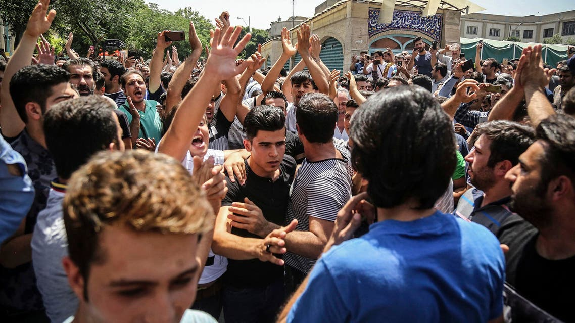 A group of protesters chant slogans at the main gate of old grand bazaar in Tehran on June 25, 2018. (Iranian Labor News Agency via AP)