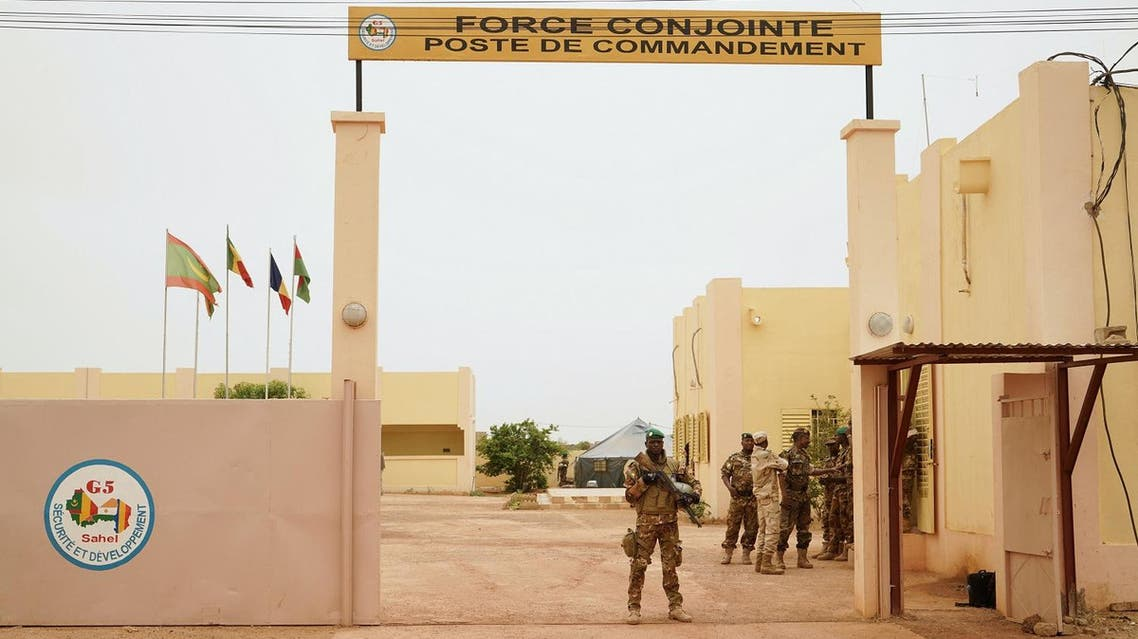 A Malian Army soldier with the G5 Sahelstands at the entrance of a G5 Sahel command post in Sevare. (AFP)