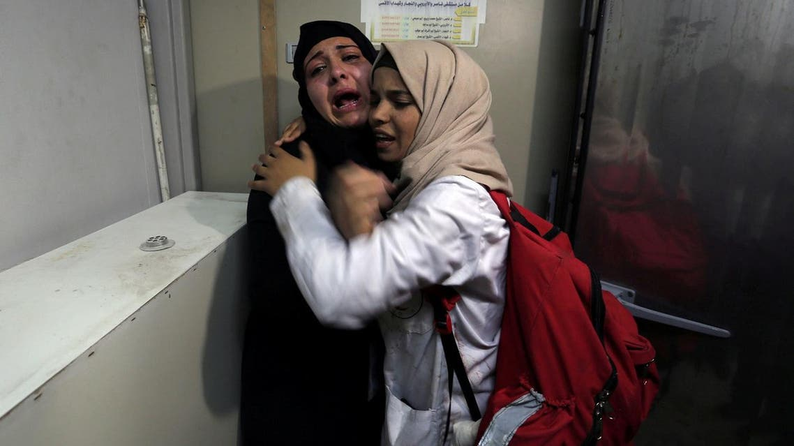 The aunt of 14-year-old Palestinian boy Yasser Abu Al-Naja, who was killed by Israeli forces at the Israel-Gaza border, reacts at a hospital morgue in the southern Gaza Strip, on June 29, 2018. (Reuters)