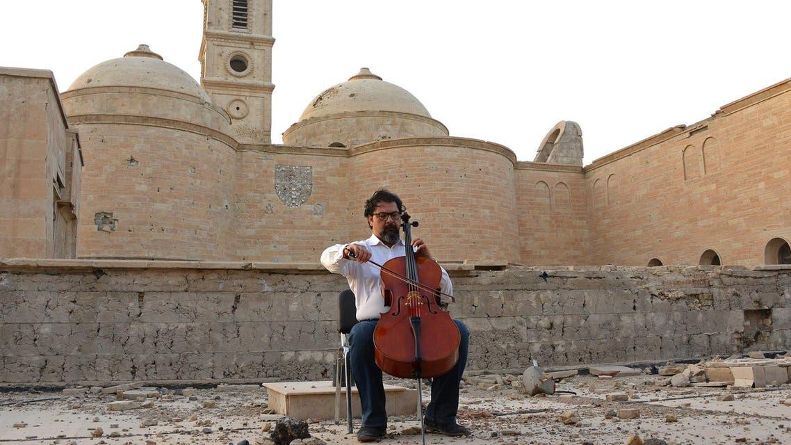 Cellist Karim Wasfi in Mosul, Iraq (AFP)
