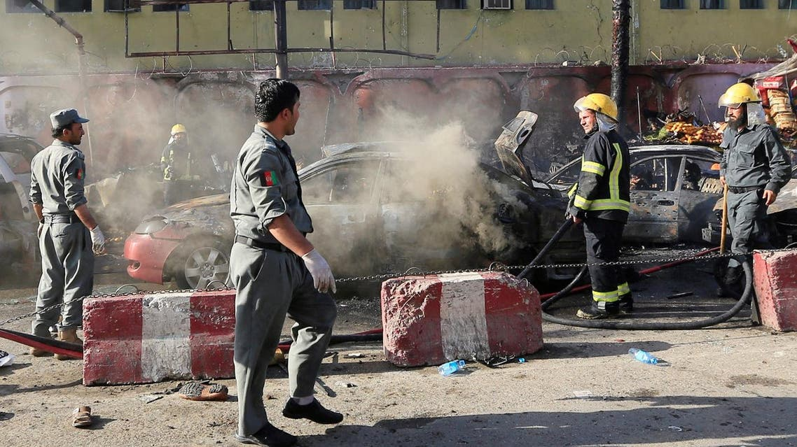 Afghan policemen inspect the site of a blast in Jalalabad city, Afghanistan, on July 1, 2018. (Reuters)